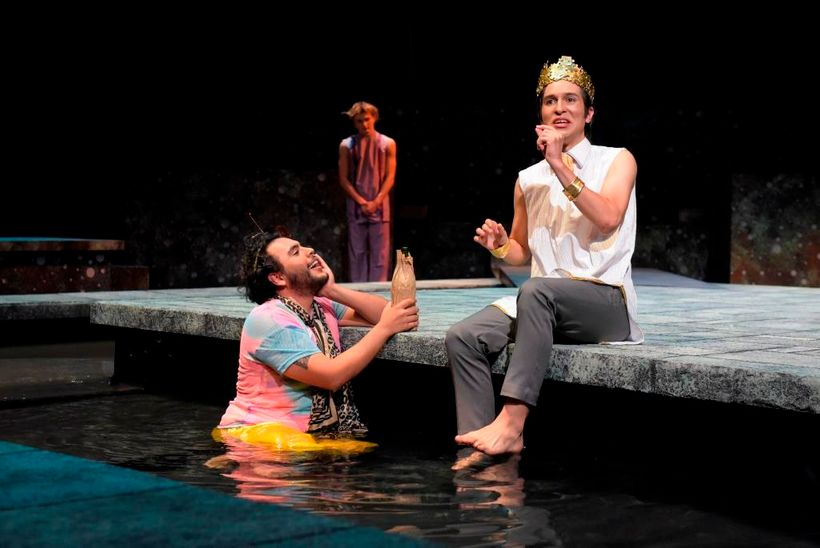 Drunken Silenus (Ivan A. Oyarzabal) regales King Midas (Alexander Espinosa Pieb) with a tale of immortality in a scene from