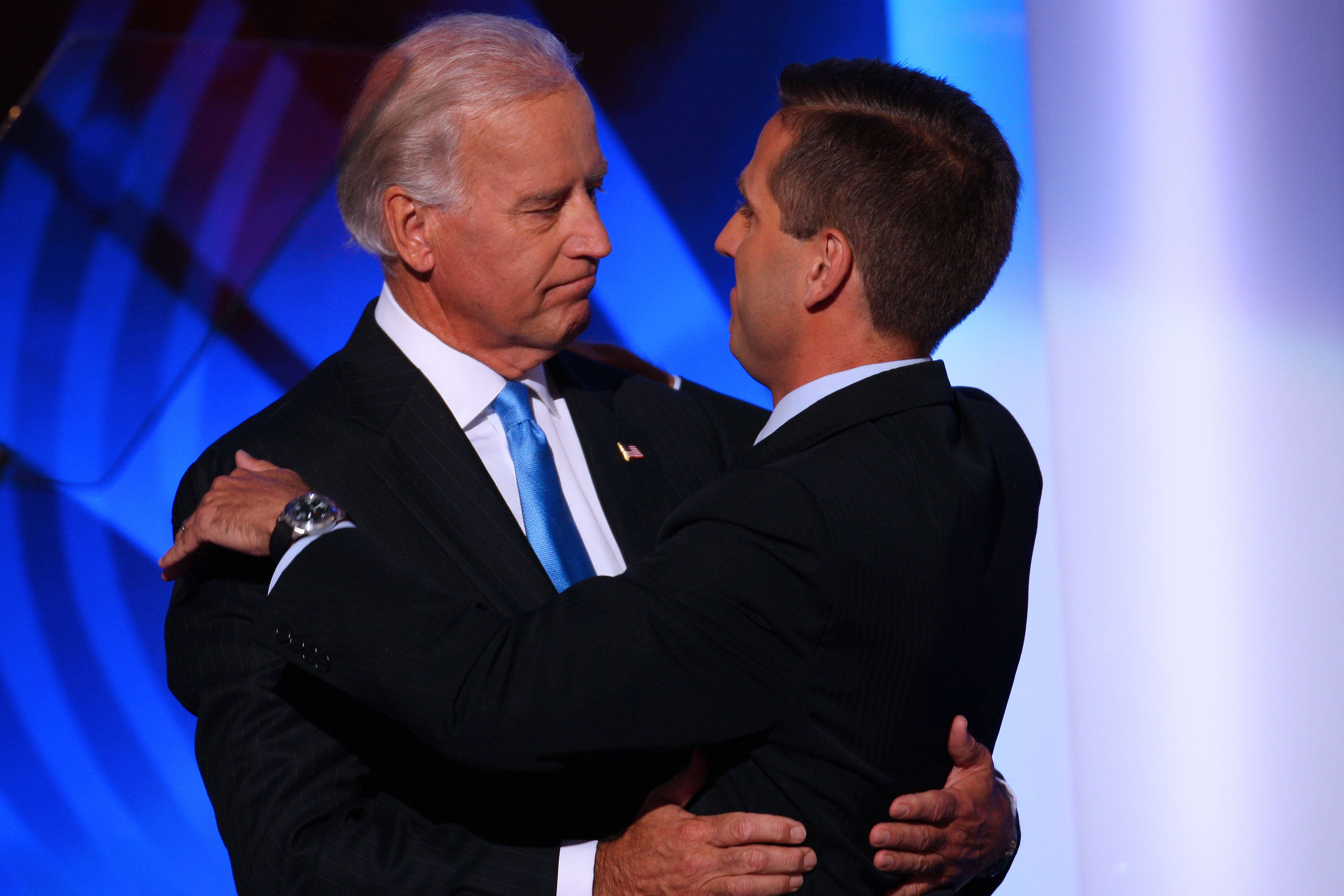 UNITED STATES - AUGUST 27:  Joe Biden, left, a Democratic senator from Delaware and vice presidential running mate of presidential candidate Senator Barack Obama of Illinois, hugs his son Joseph 'Beau' Biden, attorney general of Delaware, on day three of the Democratic National Convention (DNC) in Denver, Colorado, U.S., on Wednesday, Aug. 27, 2008. The DNC ends on Aug. 28.  (Photo by Matthew Staver/Bloomberg via Getty Images)