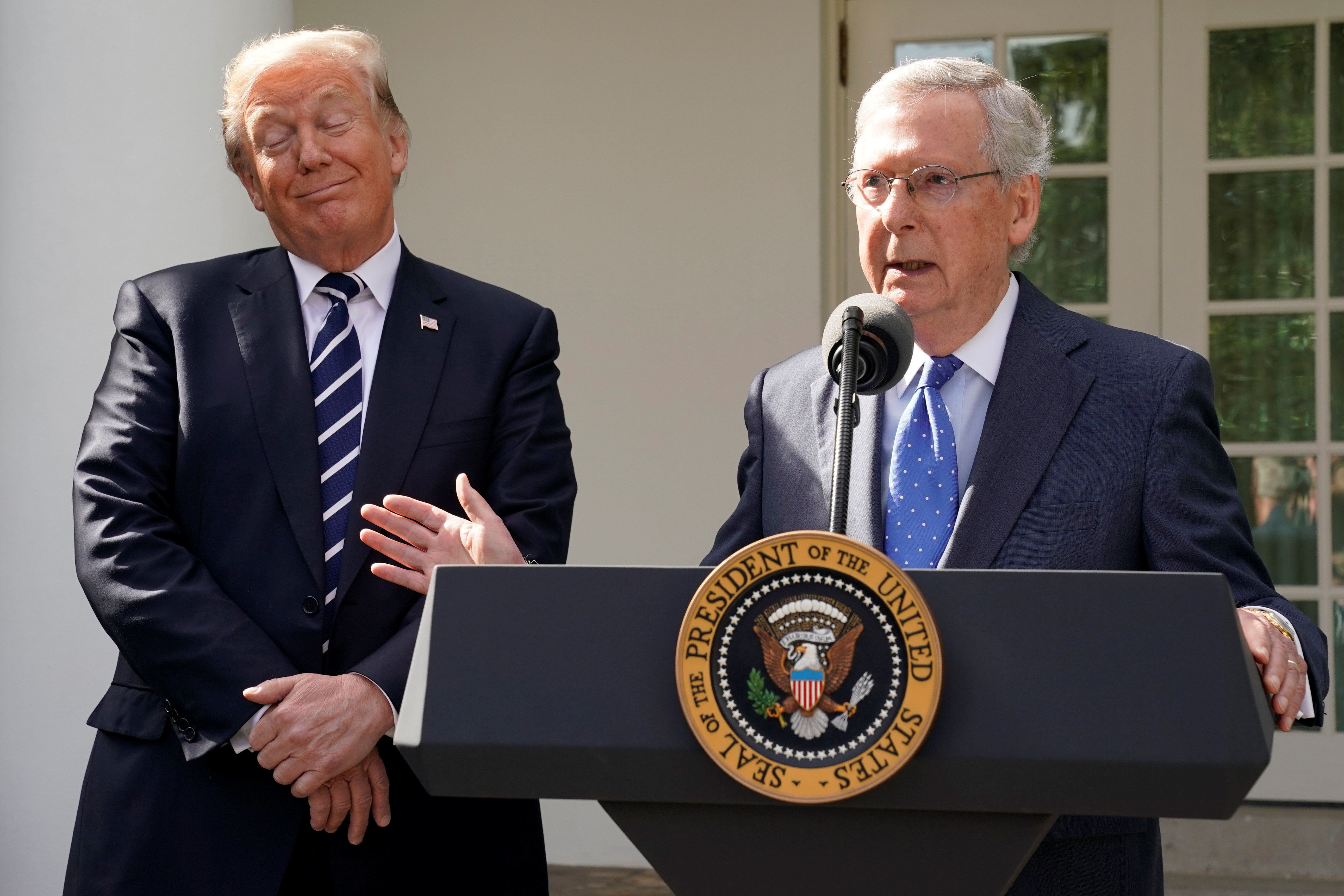 U.S. Senate Majority Leader Mitch McConnell speaks to the media with U.S. President Donald Trump at his side in the Rose Garden of the White House in Washington, U.S., October 16, 2017. REUTERS/Yuri Gripas