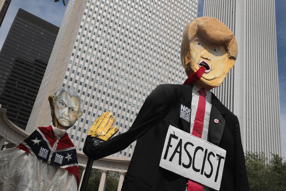 Demonstrators in Chicago protesting the alt-right and mourning Charlottesville, Virginia, victims carry puppets of President