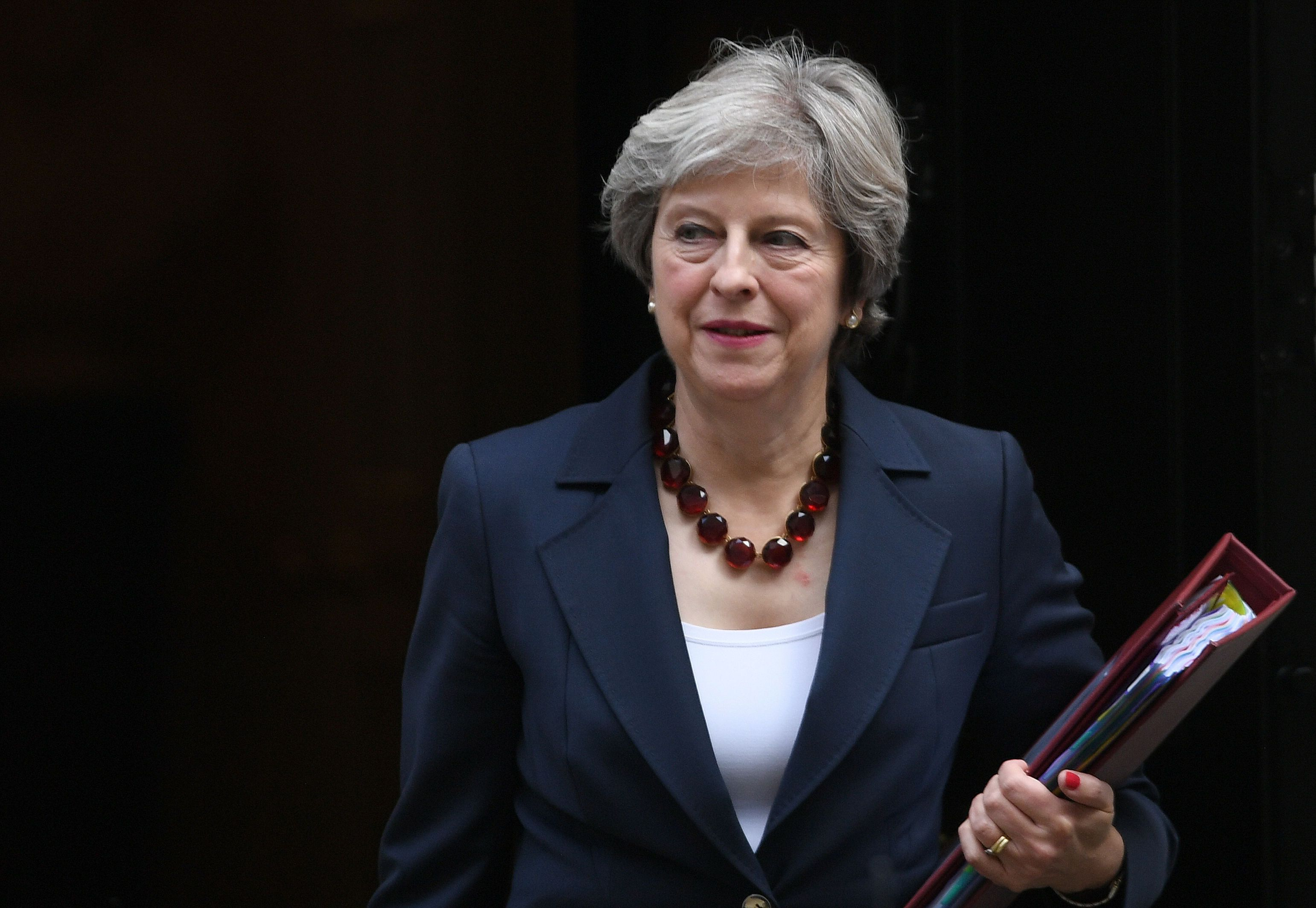 Theresa May, who commissioned the report in January, hit out at the 'injustice' people with mental health...