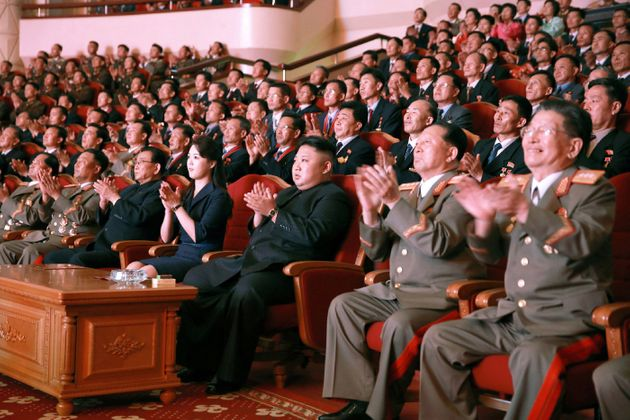 An undated photo of North Korean leader Kim Jong Un (center), released by North Korea's official...