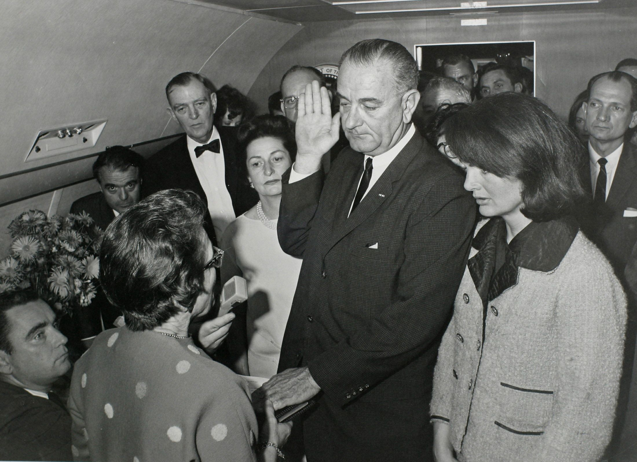 - PHOTO TAKEN 22NOV1963 - U.S. Vice President Lyndon Baines Johnson (C) takes the presidential oath of office from Judge Sarah T. Hughes (2nd from L) as President John F. Kennedy's widow first lady Jacqueline Bouvier Kennedy (2nd from R) stands at his side aboard Air Force One at Love Field in Dallas, Texas just two hours after Kennedy was shot in this November 22, 1963 photo by White House photographer Cecil Stoughton provided by the John F. Kennedy Presidential Library in Boston. Attending the swearing in are Assistant Presidential Press Secretary Malcolm Kilduff (L-front), Special Assistant to the President Jack Valenti (L-Rear), U.S. Congressman Albert Thomas (2nd from L-Rear) and U.S. Congressman Jack Brooks (Far R). The fortieth anniversary of Kennedy's assassination will be on November 22, 2003.  &W ONLY ??? USE ONLY (Credit :JFK Library/Cecil Stoughton/The White House)