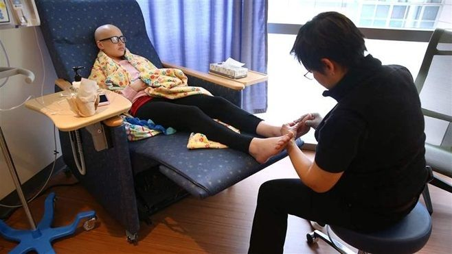 A patient receives massage therapy at the Dana-Farber Cancer Institute in Massachusetts. The state's Medicaid program is seek