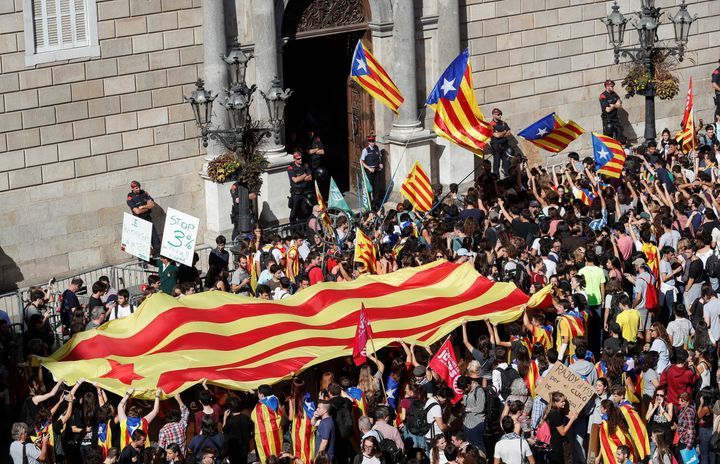 Protestors carrying Catalan seperatist flags gather outside the Generalitat Palace, the regional government headquarters, in