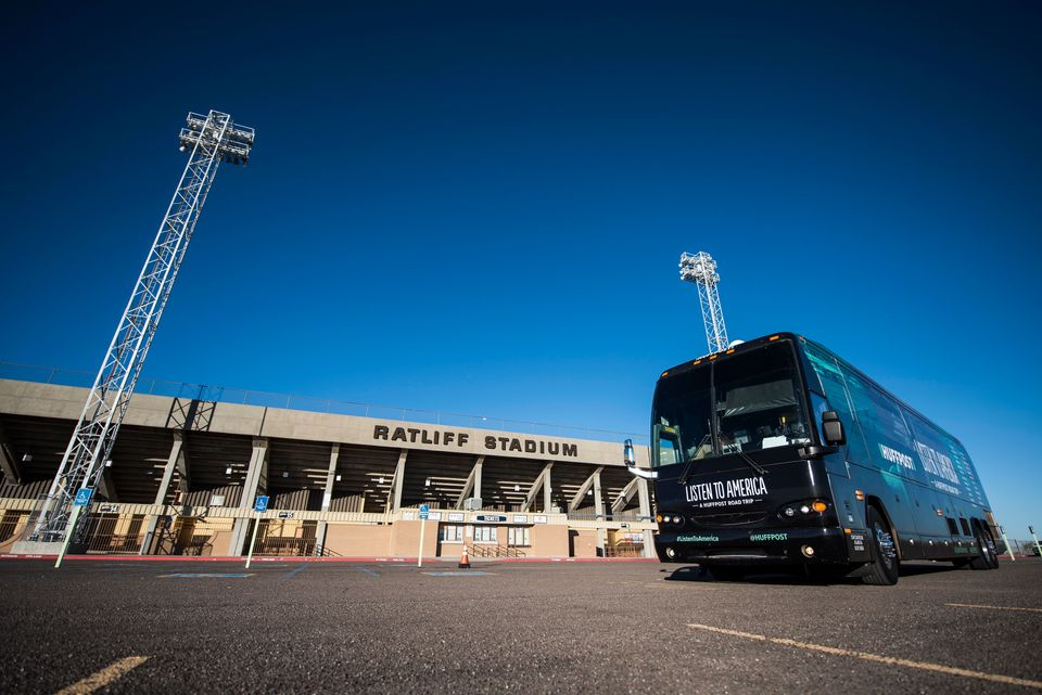 "The HuffPost tour bus sits in front of Ratliff Stadium during a visit to Odessa, Texas, on Oct. 25, 2017, as part of ""Li"