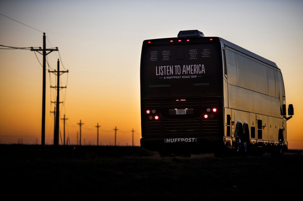 The tour bus makes its way through some rural Texas roads as the sun sets.