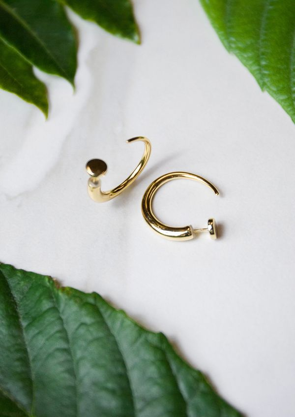 "These hoops are horn-inspired, and can be worn either backwards or forwards. Plus, <a href=""https://julessmithdesigns.com/col"