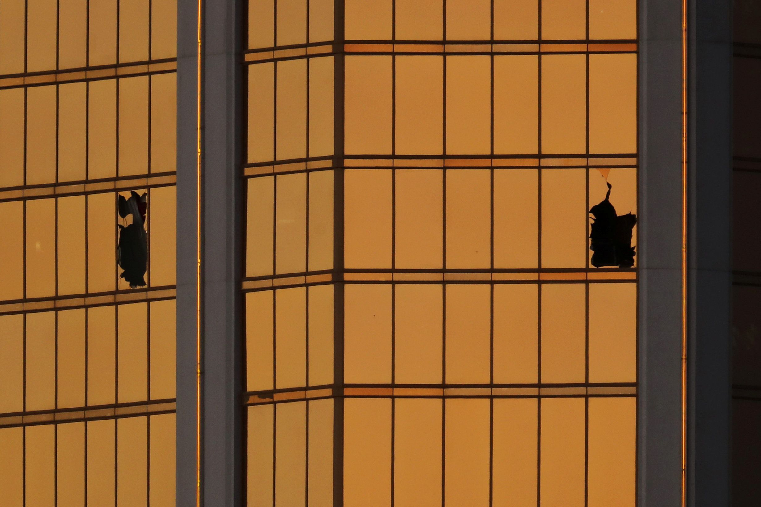 Morning light reflects off the Mandalay Bay hotel and the broken windows where shooter Stephen Paddock conducted his shooting