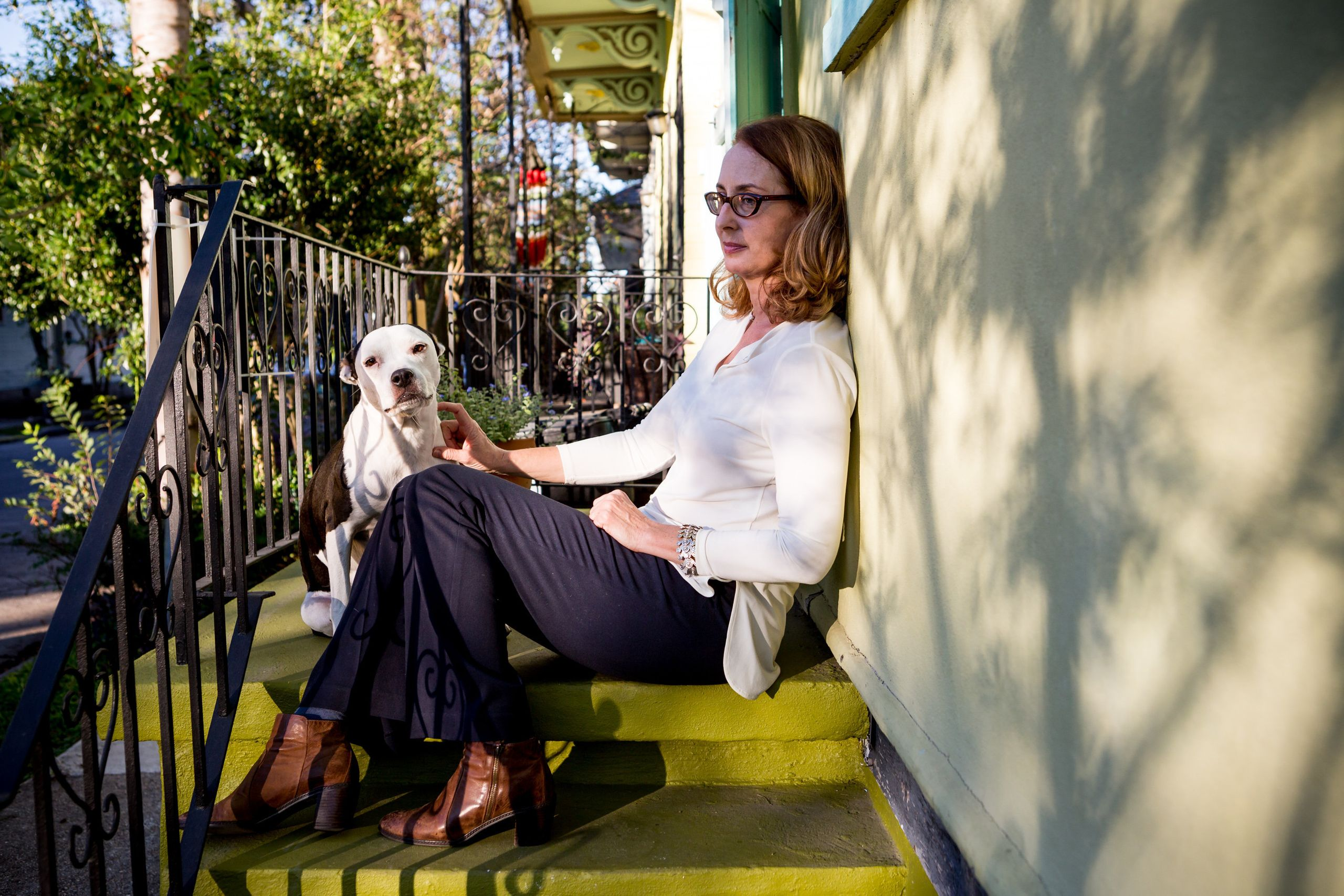 Meg Lousteau sits outside her home in the Treme neighborhood.