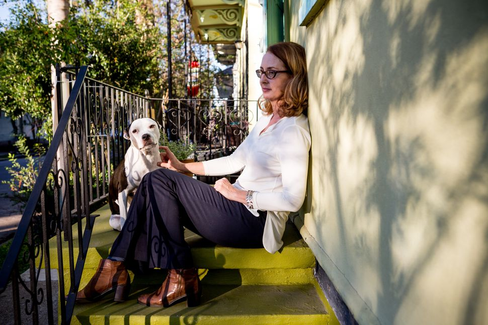 Meg Lousteau sits outside her home in the Treme