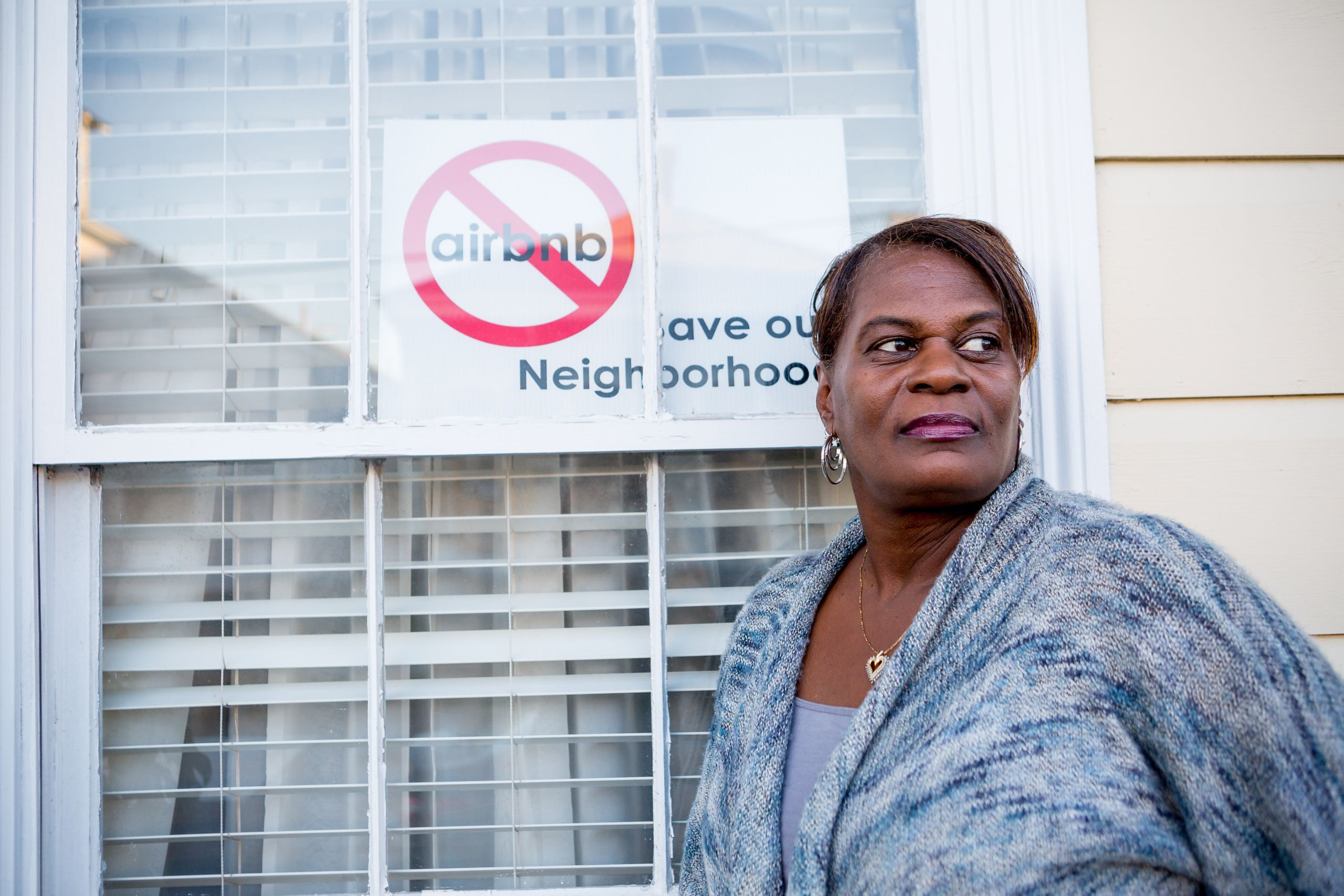 Janice Coatney stands outside her Treme home.