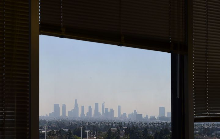 A window view of the downtown Los Angeles skyline as seen from an office building in Hollywood, California.