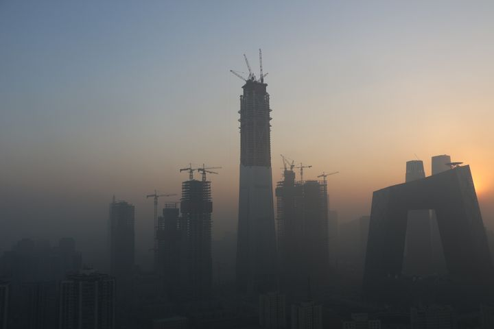 Heavy smog envelops the buildings at Beijing's central business district.