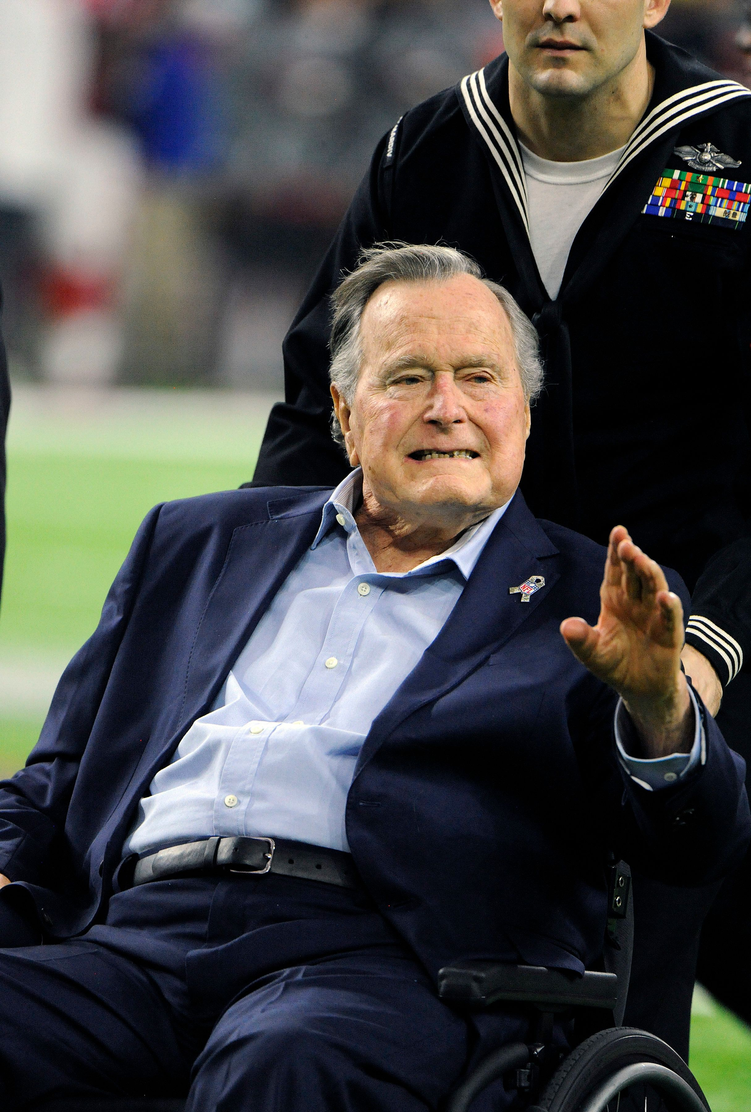 HOUSTON, TX - FEBRUARY 05:   The 41st President of the United States George Bush Sr in a wheelchair comes onto the field for the coin toss prior to the start of Super Bowl 51 between the Atlanta Falcons and the New England Patriots at NRG Stadium on February 5, 2017 in Houston, Texas. The Patriots defeat the Atlanta Falcons 34-28 in overtime. (Photo by Focus on Sport/Getty Images)