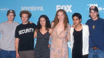SANTA MONICA, CA - AUGUST 6:   Actor Topher Grace, actor Danny Masterson, actress Mila Kunis, actress Laura Prepon, actor Wilmer Valderrama and actor Ashton Kutcher attend the Second Annual Teen Choice Awards on August 6, 2000 at the Barker Hangar, Santa Monica Air Center in Santa Monica, California. (Photo by Ron Galella, Ltd./WireImage)