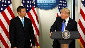 U.S. President Donald Trump speaks at the first meeting of the Presidential Advisory Commission on Election Integrity co-chaired by Kansas Secretary of State Kris Kobach (L) at the White House in Washington, U.S., July 19, 2017.  REUTERS/Kevin Lamarque