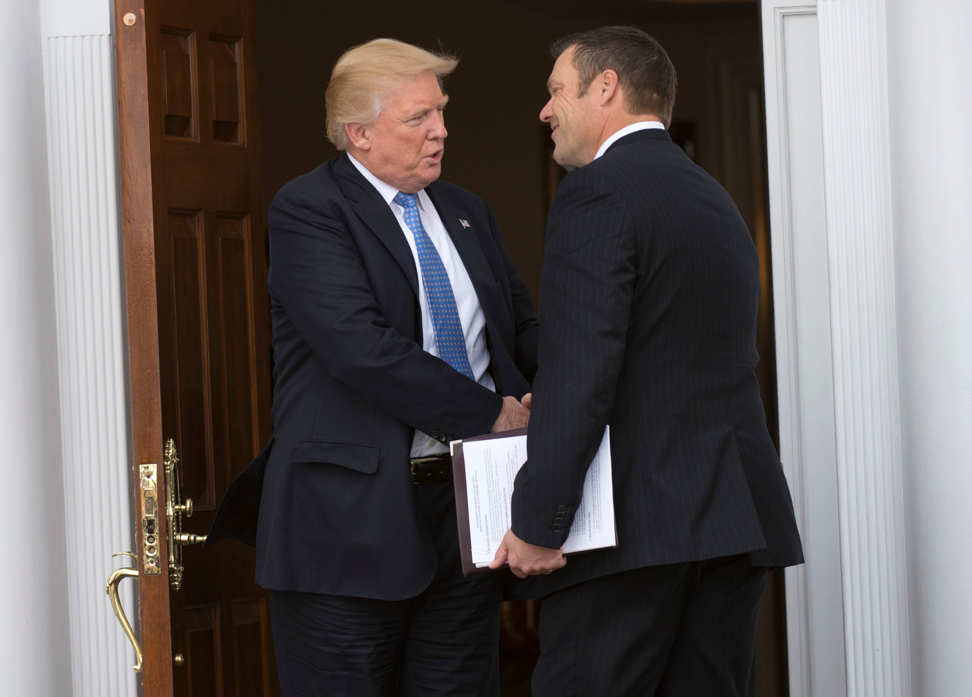 President-elect Donald Trump meets with Kris Kobach at the clubhouse of Trump National Golf Club November 20, 2016 in Bedminster, New Jersey. / AFP / Don EMMERT        (Photo credit should read DON EMMERT/AFP/Getty Images)