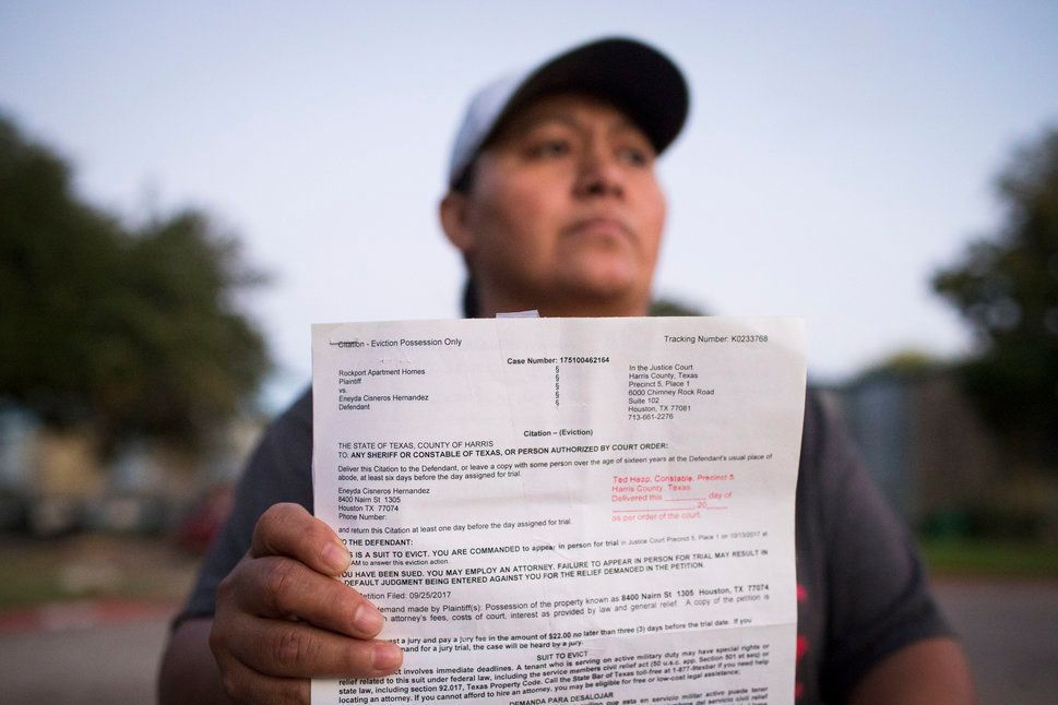 Eneyda Cisneros Hernandez holds an eviction citation she received from Rockport Apartment Homes, the complex where she lives in Houston, Sunday, Oct. 22, 2017. ( Marie D. De Jesus / Houston Chronicle )