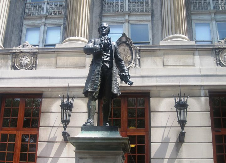 "Alexander Hamilton's statue adorns Hamilton Lawn at the founder's alma mater, Columbia University. The ""Little Lion"" penned <"