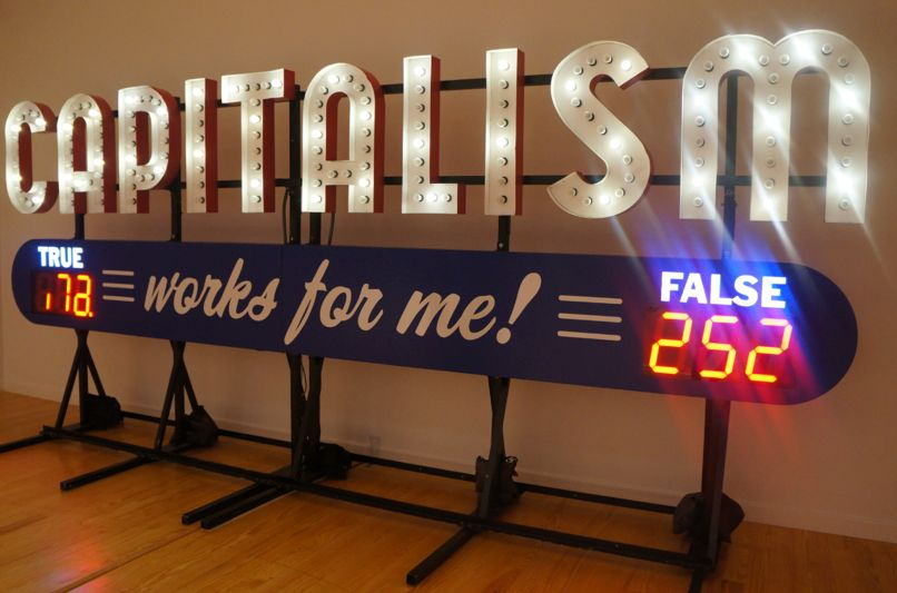 <em>Capitalism Works For Me! True/False</em>, 2011 (aluminum and electrical) by Steve Lambert