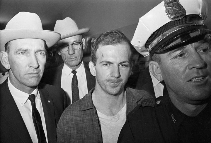 Twenty-four-year-old ex-marine Lee Harvey Oswald is shown after his arrest here on November 22. He received a cut on his fore