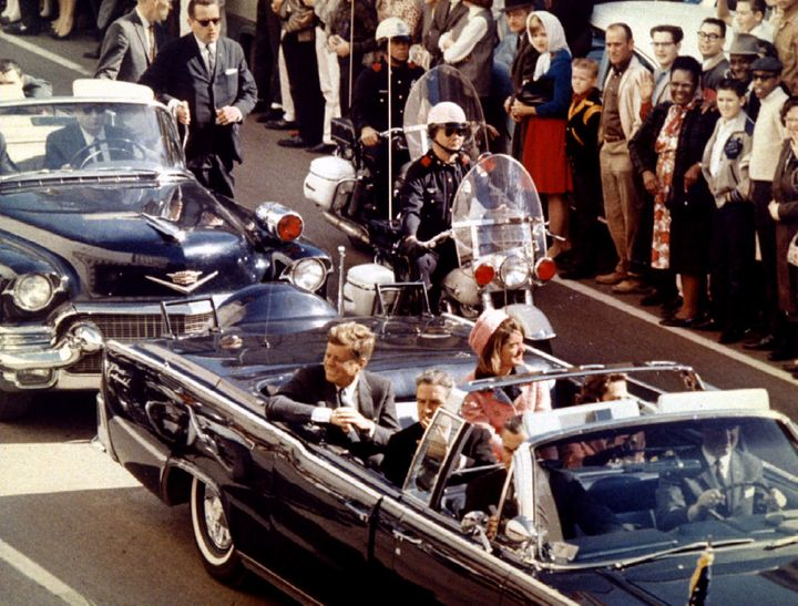 President and Mrs. John F. Kennedy, and Texas Governor John Connally ride through Dallas moments before Kennedy was assassina