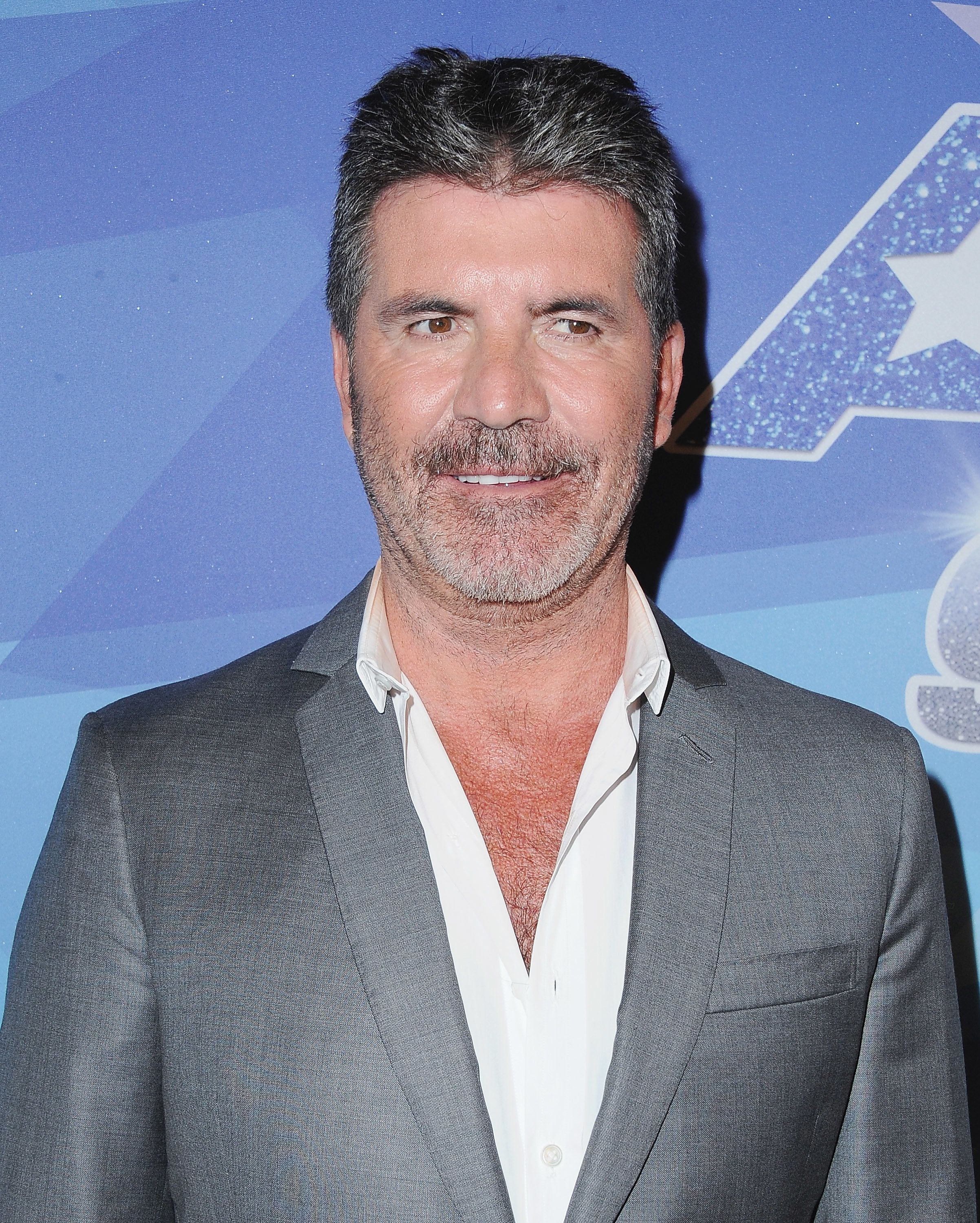 Simon Cowell Rushed To Hospital After Falling Down Stairs At London