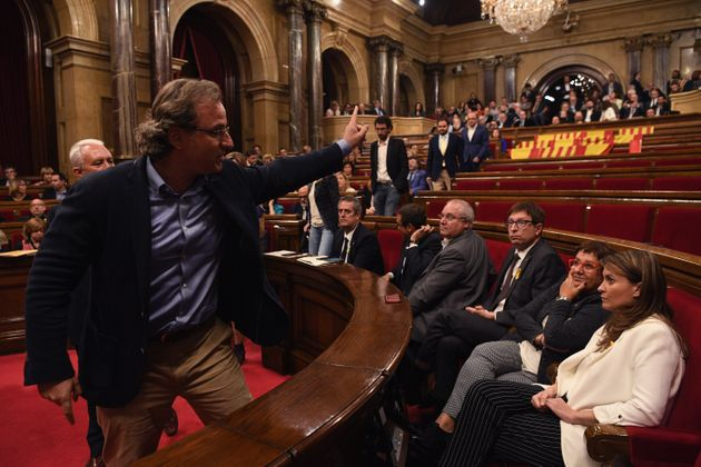 Members of the People's Party of Catalonia leave the chamber before the vote on