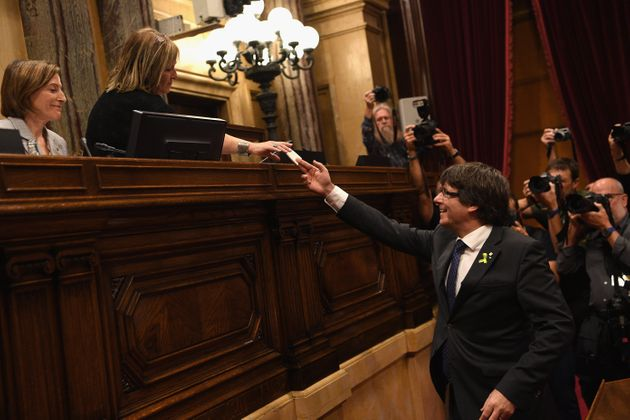 Catalan President Carles Puigdemont casts his vote for independence from