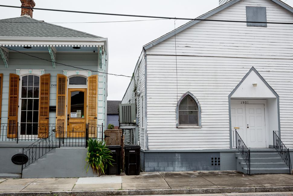 One of Treme's whole-home rentals (left) stands next to a neighborhood