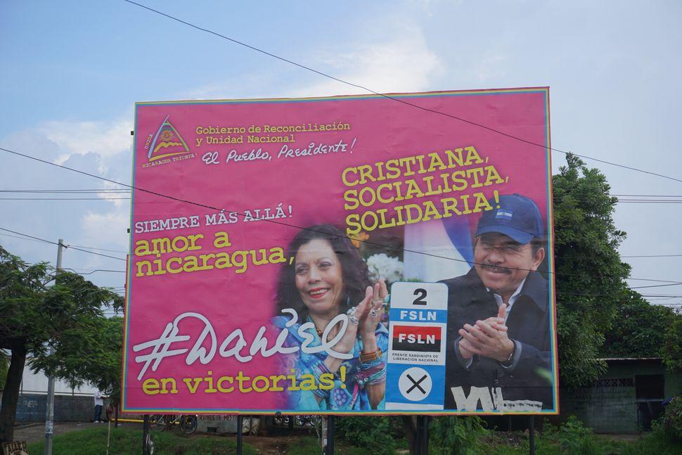 "A sign near the German Nicaraguan Hospital in Managua bears President Daniel Ortega's slogan: ""Christian, Socialist, Solidari"