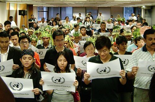 Reading the UDHR on International Human Rights Day, 2007, in Kuala Lumpur, Indonesia (Source: The Public First Program)