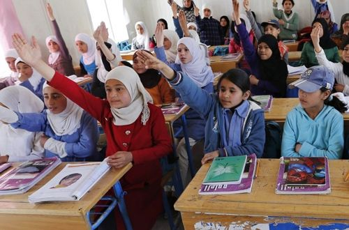Syrian refugee students attend a class in a UNICEF school at the Al Zaatari refugee camp in Mafraq (Source: Thomson Reuters F