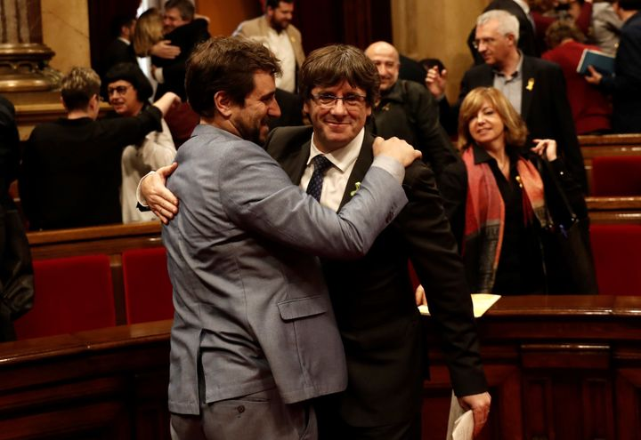 Catalan regional President Carles Puigdemont (R) celebrates after Catalonian Parliament declared independence following the s