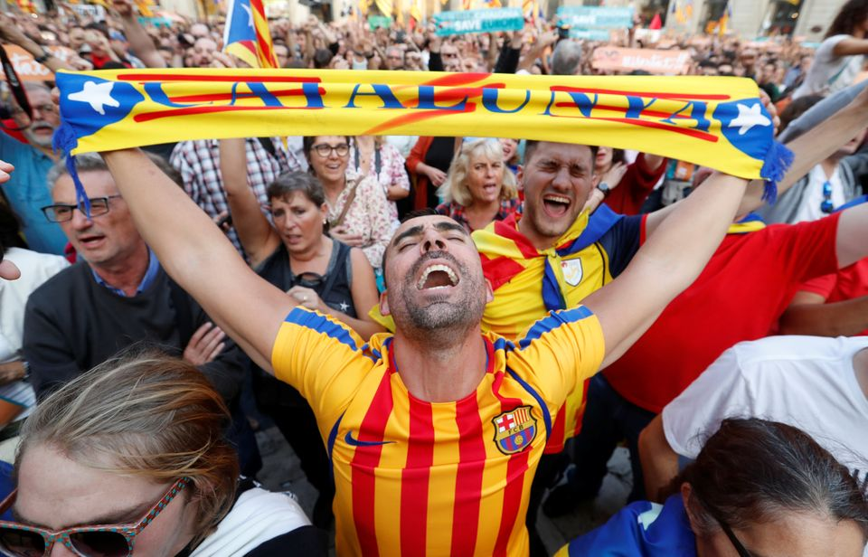 People react at Sant Jaume Square in Barcelona after the Catalan regional parliament declares independence...