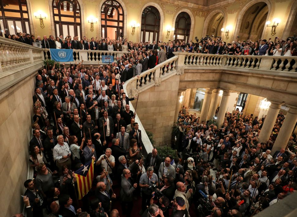 Catalan government members, pro-independence deputies and mayors from pro-independence towns sing the Catalan anthem after th