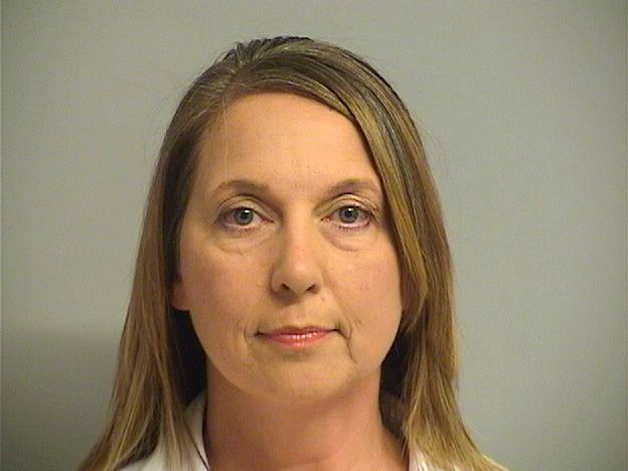 Tulsa, Oklahoma Police Officer Betty Shelby, 42, charged with first-degree manslaughter in the death of 40-year-old Terence Crutcher, is shown in this Tulsa County Jail booking photo in Tulsa, Oklahoma, U.S., September 23, 2016.  Courtesy Tulsa County Jail/Handout via REUTERS    ATTENTION EDITORS - THIS IMAGE WAS PROVIDED BY A THIRD PARTY. EDITORIAL USE ONLY