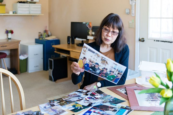Patricia Martin looks through old photographs of her husband on April 14. Bob Martin, a family practice physician, died in 20