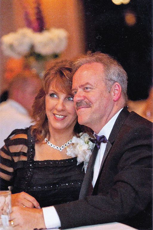 Jim and Leeanne Mills of West Liberty, Ky., celebrate at the 2014 wedding of their daughter. Leeanne Mills died in hospice ca