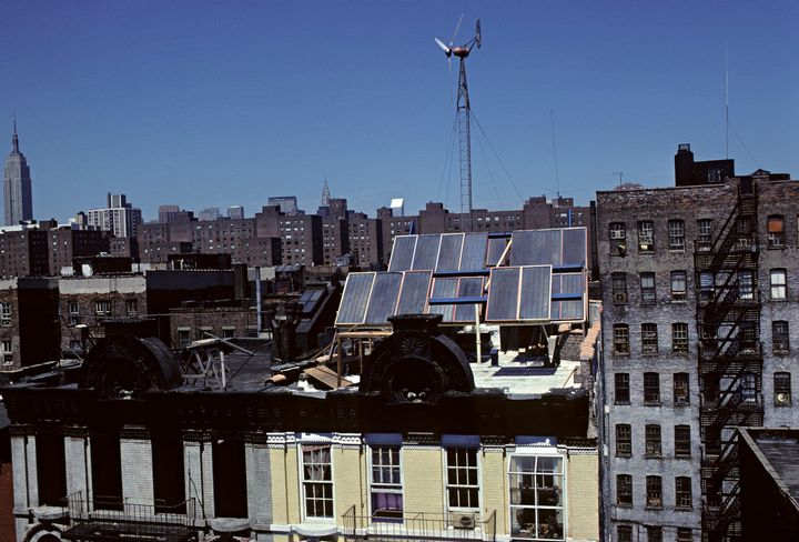 A renovated apartment building with solar panels and a wind-powered generator on New York City's Lower East Side.