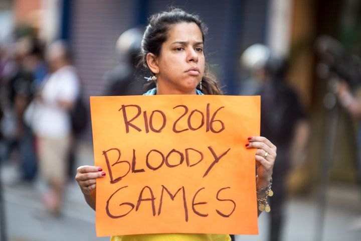 Thousands of people demonstrate against the Olympic Games Rio 2016 and Brazil's interim President Michel Temer at Saens Pena Square, in Rio de Janeiro, Brazil, on August 5, 2016.