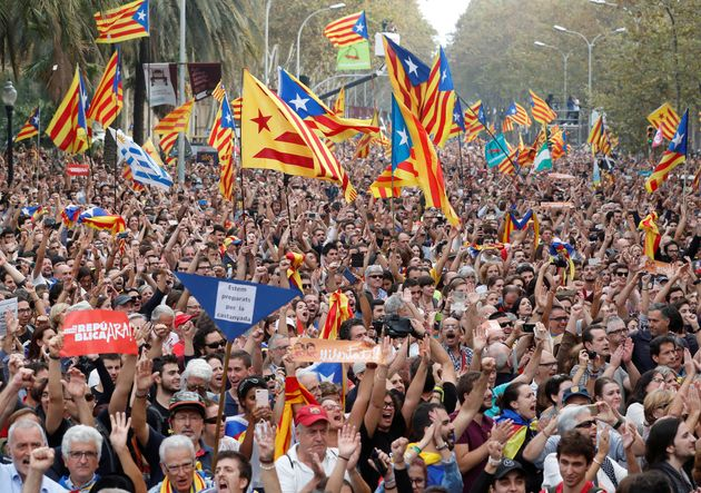 People celebrate in Barcelona after the Catalan regional Parliament there voted for independence from...