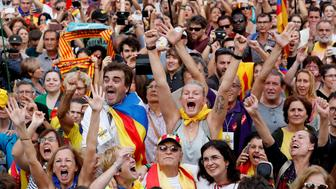 People celebrate after the Catalan regional parliament passes the vote of independence from Spain in Barcelona, Spain October 27, 2017. REUTERS/Yves Herman