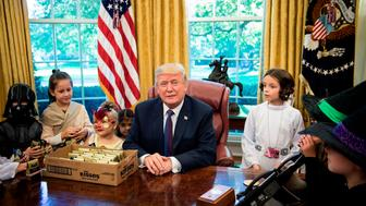 US President Donald Trump meets with children of members of the press for Halloween in the Oval Office of the White House in Washington, DC, on October 27, 2017. / AFP PHOTO / Brendan Smialowski        (Photo credit should read BRENDAN SMIALOWSKI/AFP/Getty Images)