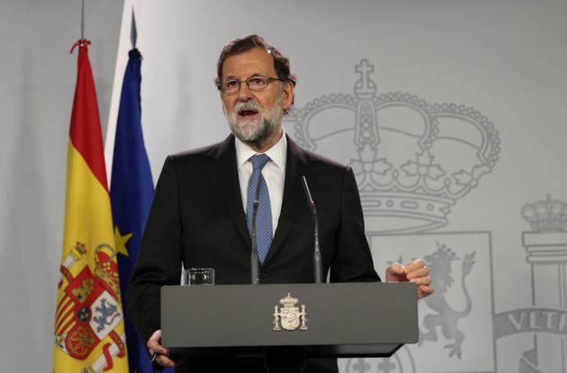 Spain's Prime Minister Mariano Rajoy delivers a statement after an extraordinary Cabinet meeting at the...