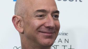 A beaming Jeff Bezos turns up on the red carpet at an event for the Smithsonian Magazine late last year
