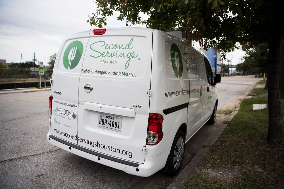 """A van owned by """"Second Servings,"""" an organization that picks up leftover food and gives it to those in need, is parked at Mid"""