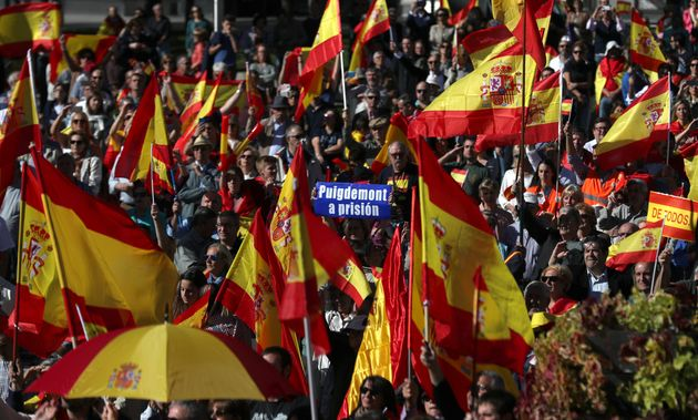 Pro-unity demonstrators gather with a sign calling for the imprisonment of sacked Catalan President Carles...