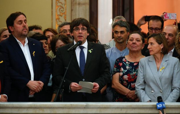Carles Puigdemont speaks during a ceremony on Friday after the regional parliamentpassed its